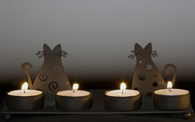 candlestick with cats