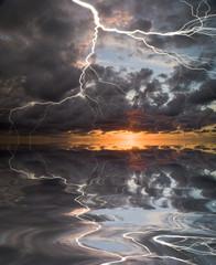 Lightning on sunset sky background