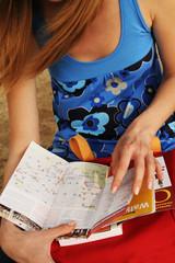 Women leafing a book