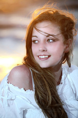 young beautiful girl on the beach at sunset