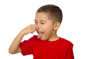 kid holding his nose from bad odor, isolated on white