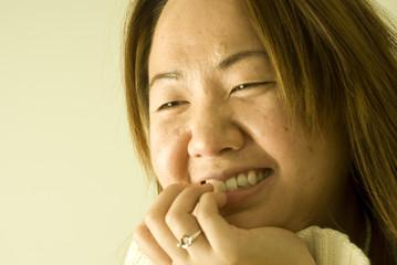 Beautiful young Asian woman, smiling, laughing