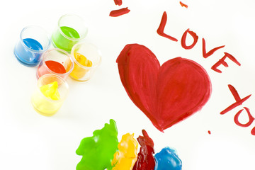 """Colorful painting on white paper saying """"I love you """""""