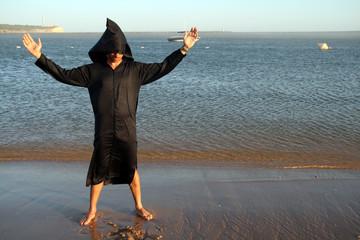 berber man standing on a beach