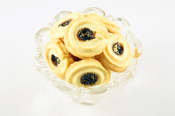 Delectable fruit filled biscuit nestled in a lovely glass dish.