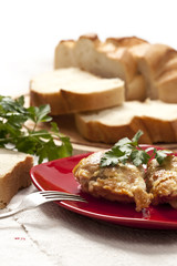 Roasted chicken in butter with bread and greenery