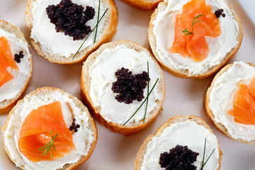 Mini sandwiches - bagel with cream cheese,  salmon, caviar