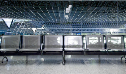 Empty seats in an airport waiting room or lounge