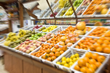 A shot of fruit and vegetables section in a grocery store. Blur