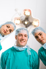 group of surgeons in operation room