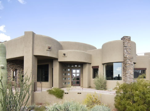 New Adobe style modern home exterior in Arizona