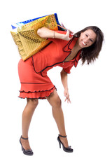 The young beautiful girl with purchases during shopping