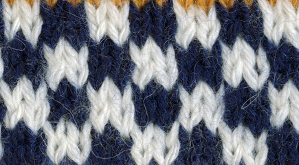 The structure of a needlework, knitting, weaving.