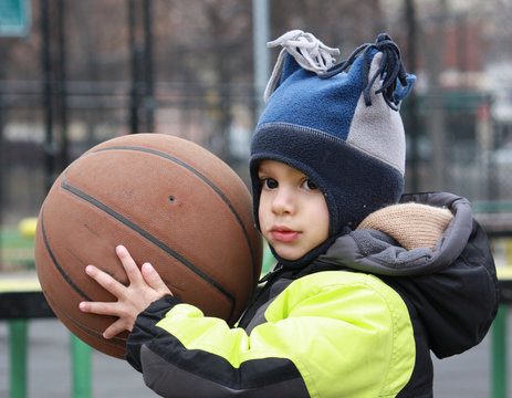 Little boy with a basketball
