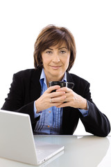 Senior businesswoman drinking coffe