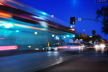 Fotobehang - Speeding bus, blurred motion