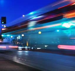 Fotobehang - Speeding bus, blurred motion