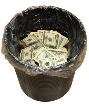 A money is in a trash bucket. Isolated,with clipping path