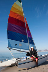captain on his catamaran