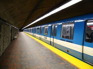 A subway leaving a station