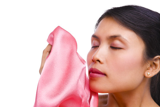 young woman smelling fresh laundry
