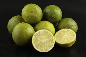 Limes on black background