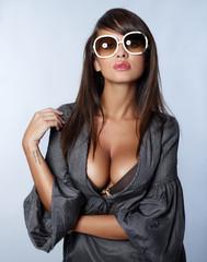Portrait of beautiful sexy woman on blue