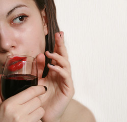 Portrait of the girl with a glass of wine.