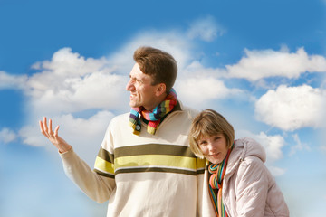 young couple over sky background