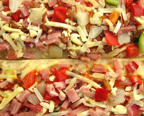 Pizza with ham, cheese and vegetables