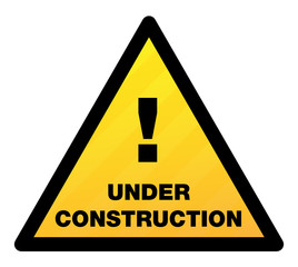 glossy yellow sign - under construction