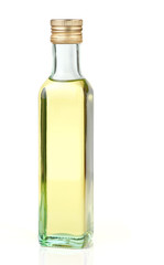 Grape seed oil in glass bottle, isolated