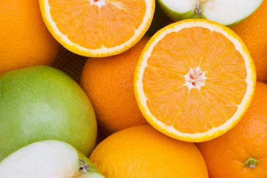 Close  up of half cut oranges and apples