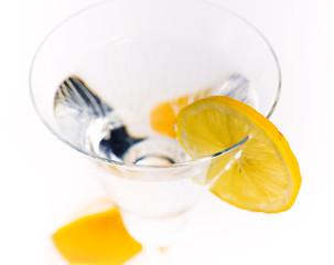 Glass with a lemon segment