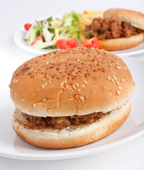 minced meat burger with another burger at the back