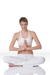 Smiling woman in yoga position