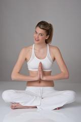 Blond girl in yoga position