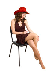 beautiful girl in a red hat and brown dress
