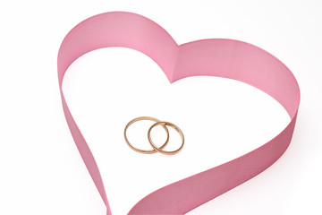 Wedding rings in heart from a tape