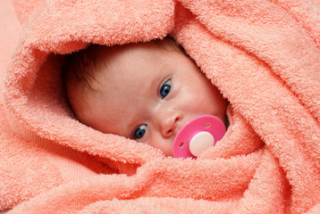 newborn baby with soother