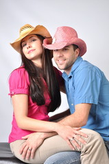 couple in cowboy hats