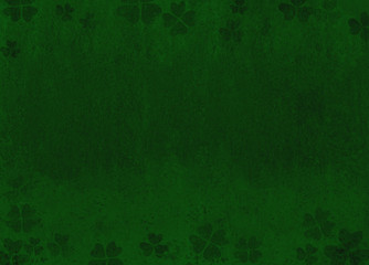 Green grungy textured background with clovers
