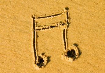 note de musique sur la plage