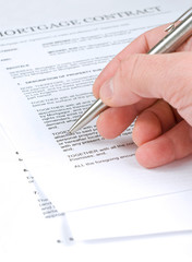 Man examining mortgage contract
