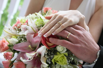 flowers and hand with rings marriage love