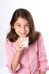 Young Girl drinking glass of milk