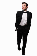Man in tuxedo stepping out