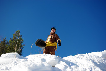 Standing snowboarder on slope