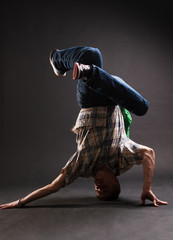 breakdancer standing in complicated pose