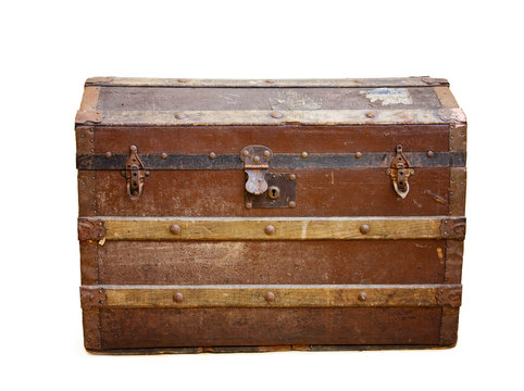 Antique rusty travel trunk over white with clipping path